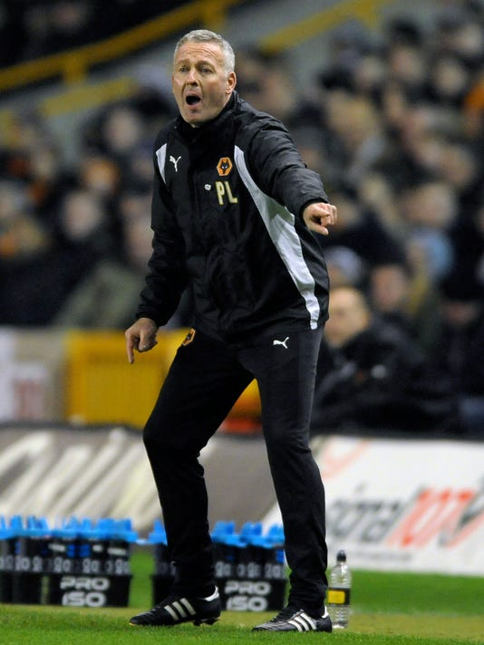 FILE - In this file photo dated Saturday, Feb. 18, 2017, Wolverhampton Wanderers manager Paul Lambert reacts during the English FA Cup Fifth Round soccer match against Chelsea at Molineux stadium in Wolverhampton, England.  Stoke has hired Paul Lambert to manage the Premier League club, according to an announcement Monday Jan. 15, 2018. (AP Photo/Rui Vieira, FILE)