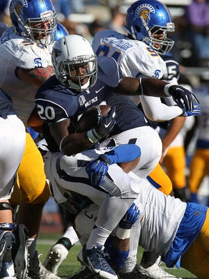 Wolf Pack running back James Butler and Nevada open the season Friday against Cal Poly.