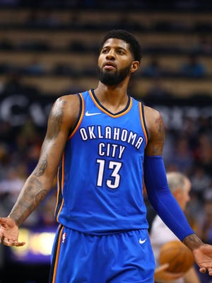Oklahoma City Thunder forward Paul George (13) reacts against the Phoenix Suns at Talking Stick Resort Arena.