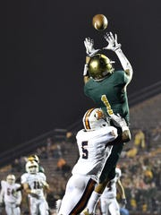 Knoxville (Tenn.) Catholic's Dashon Bussell (1) goes up to make a touchdown catch in front of Beech's Jahmall Robinson (5) during the first half of the Class 5A state championship game at Tucker Stadium in Cookeville, Tenn., Thursday, Nov. 30, 2017.Bussell has signed with Western Michigan University.