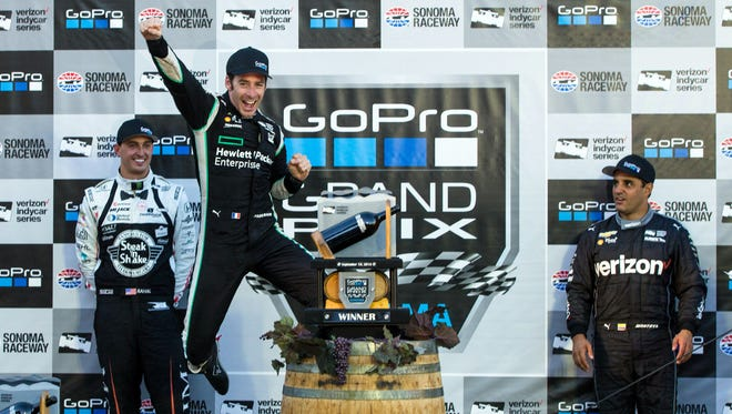 Hewlett Packard Enterprise driver Simon Pagenaud  celebrates after winning the GoPro Grand Prix of Sonoma at Sonoma Raceway.