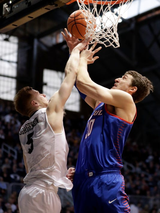 Butler guard Paul Jorgensen (5) blocks the shot of DePaul forward Peter Ryckbosch (30) in the second half of an NCAA college basketball game in Indianapolis, Saturday, Feb. 3, 2018. Butler defeated DePaul 80-57. (AP Photo/Michael Conroy)