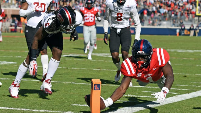 A.J. Brown (1) caught 14 passes, which tied an Ole Miss single-game record, for 185 yards and two touchdowns Saturday.