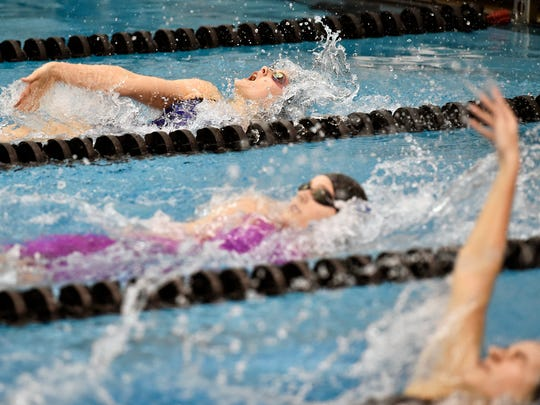 West York's Claudia Keller, top, swims the 100-yard backstroke for a first-place finish in the YAIAA Swimming Championships Friday, Feb. 10, 2017, at Central York.
