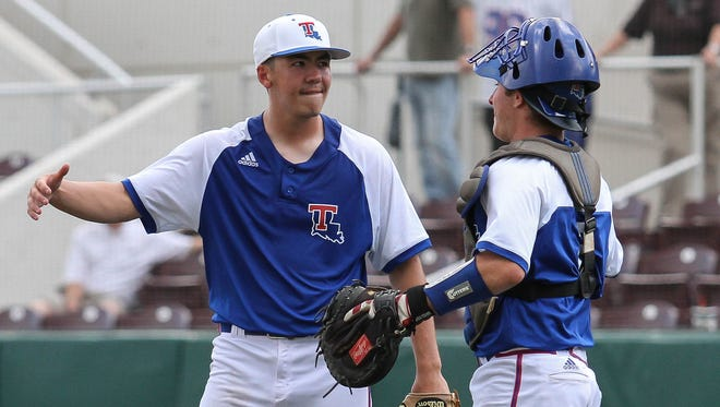 Louisiana Tech's Nate Harris celebrates his team's 6-2 victory over Cal State Fullerton with catcher Brent Diaz during their NCAA college baseball regional tournament game at Dudy Noble Field in Starkville, Miss., Sunday, June 5, 2016. (James Pugh/The Laurel Chronicle, via AP)