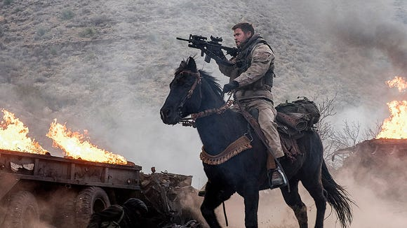 Chris Hemsworth on his steed in '12 Strong.'