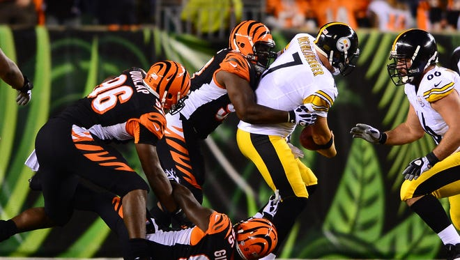 Pittsburgh Steelers quarterback Ben Roethlisberger (7) is sacked by defensive end Wallace Gilberry (95), defensive end Carlos Dunlap (96) and defensive end Michael Johnson (93) at Paul Brown Stadium in 2013.