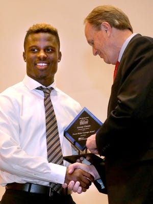 First Tennessee President Phil Holt hands out one of the two Travis Weber Courage Awards to George Gbesee on May 3, 2015. The other Courage Award winner was Jasper Snowden.