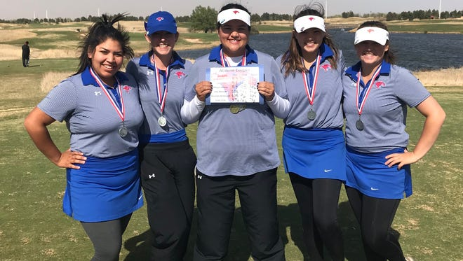 Cooper's Sarah Aitchison, center, won the District 4-5A girls golf title on Tuesday in Lubbock, while the rest of the team also earned a region berth with a second-place finish.