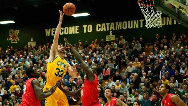 Vermont's Ethan O'Day (32) leaps to take a shot over Stony Brook's Jameel Warney, center, during the first half of Saturday's America East men's basketball game at Patrick Gymnasium.