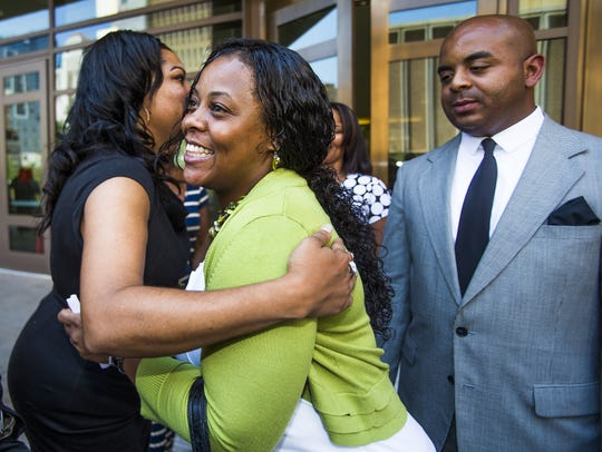 Shanesha Taylor is hugged after being released from