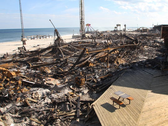 Firefighters on the scene near the FunTown Pier. Total destruction to the Seaside Park and Seaside Heights boardwalk is seen looking south from the upper deck of the Beachcomber night club. Tom Spader/Asbury Park Press