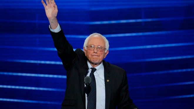 Former Democratic presidential candidate, Sen. Bernie Sanders, I-Vt., waves to the delegates before addressing the first day of the Democratic National Convention in Philadelphia , Monday, July 25, 2016.