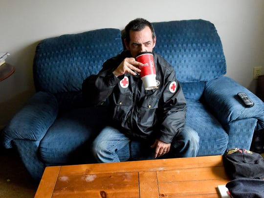 Hal Porter sits in his apartment at Farrier Court drinking coffee and watching morning television on Thursday, April 9, 2015.
