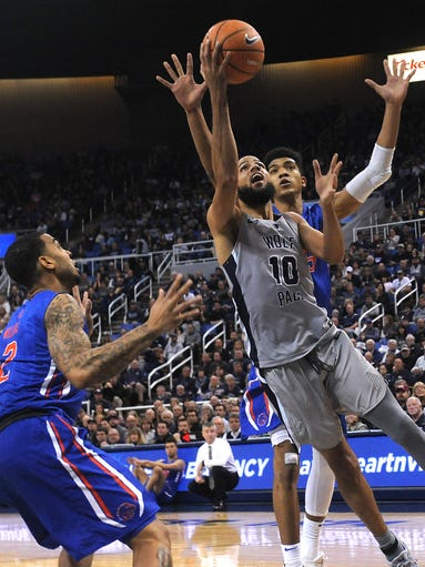 Nevada's Caleb Martin (10) drives to the basket while