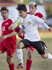 Golden West's Richard Chavez gets a face full of ball of the foot of Santa Maria's Miguel Tena in a CIF SoCal Regional first-round playoff game on Tuesday, March 7, 2017.