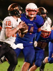 St. Cloud Apollo's Blake Louangsyharaj tries to chase