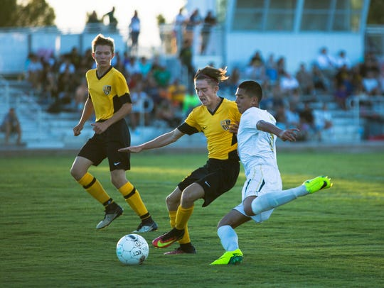 Mayfield forward Cesar Mendez goes fights an Alamogordo