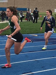 Madison freshman Chesney Davis competes in the 4x200