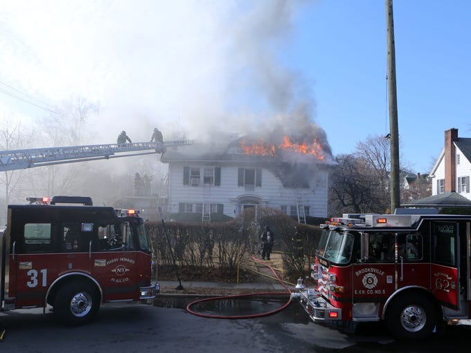 Firefighters respond to a house fire at 340 King St.