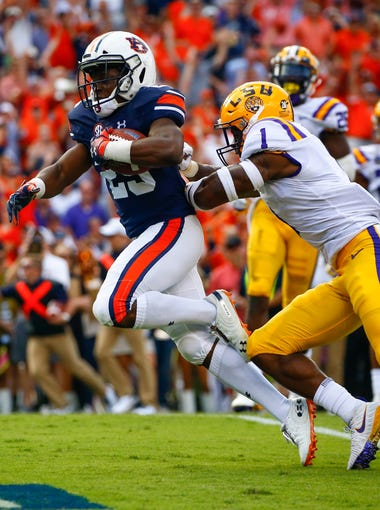Auburn running back Shaun Shivers (25) gets past LSU cornerback Kelvin Joseph (1) for a touchdown during the first half of an NCAA college football game, Saturday, Sept. 15, 2018, in Auburn, Ala. (AP Photo/Butch Dill)