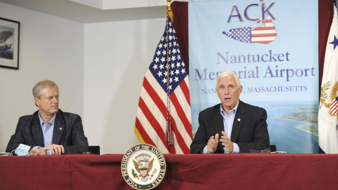 Gov. Charles Baker, left, listens to Vice President Michael Pence speak about the federal response to the COVID-19 pandemic in Nantucket on Saturday afternoon. Pence visited the island for a campaign fundraising event.