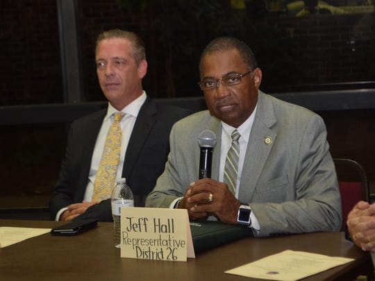Jeff Hall (right), who was unopposed in the House District 26 race, talks during Thursday's candidate forum in Pineville.