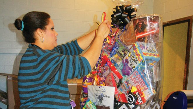 Fairview Elementary PTO members prepare the popular classroom baskets for this Saturday's auction.