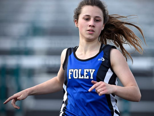 Rachael Batty crosses the finish line in the 100-meter hurdles during the Subsection 5A track meet Tuesday in Holdingford.
