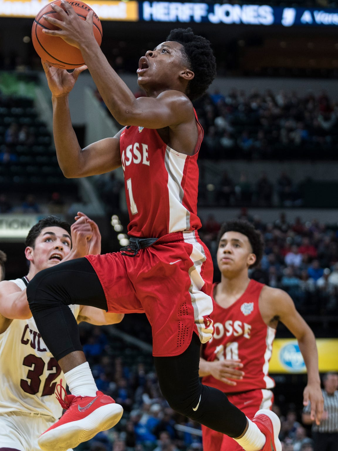Bosse's Jaylin Chinn (1) goes for a lay up during the IHSAA Class 3A State Championship at Bankers Life Fieldhouse in Indianapolis, Saturday, March 24. The Bulldogs were defeated by the Culver Academies Eagles, 64-49.