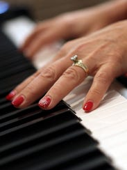 Abby Lorenz plays the piano at her church, Jerusalem