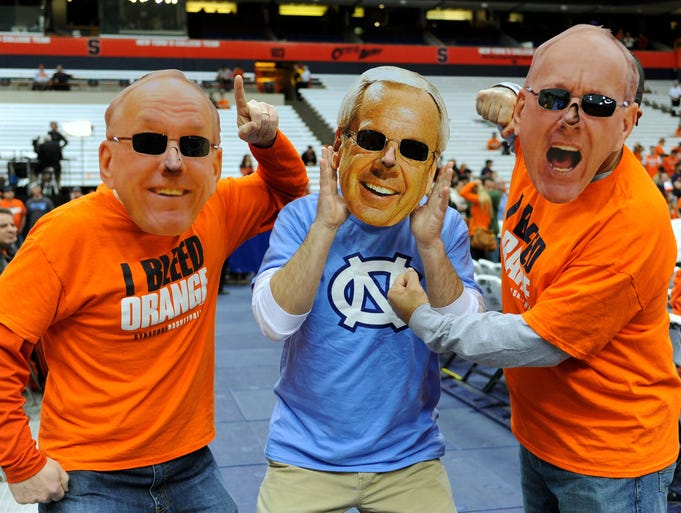 Syracuse Orange fans dressed as head coach Jim Boeheim joke with a fan dressed as North Carolina Tar Heels head coach Roy Williams prior to the game Jan. 11 at the Carrier Dome.