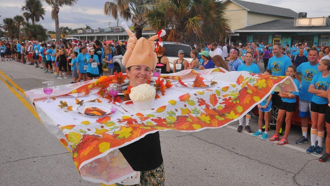 Jessica Khodadad ran the 2017 Cocoa Beach Turkey Trot dressed as a Thanksgiving dinner table.