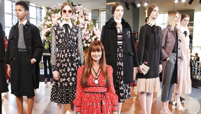 Kate Spade CEO Deborah Lloyd poses with models during the Kate Spade New York presentation during Fall 2016 New York Fashion Week at The Rainbow Room in New York City.
