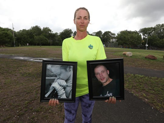 Allison Willis of Suffern with photos of her daughter, Ava, and late husband, Jason Schulman, at Memorial Park in Nyack July 23, 2018. Schulman died from a heroin overdose in 2015.