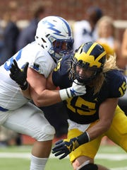 Michigan's Chase Winovich battles Air Force's Parker Wilson in the second quarter Saturday, Sept. 16, 2017 at Michigan Stadium.