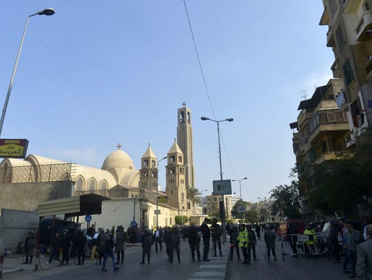 At least 22 killed by blasts near Cairo cathedral: reports