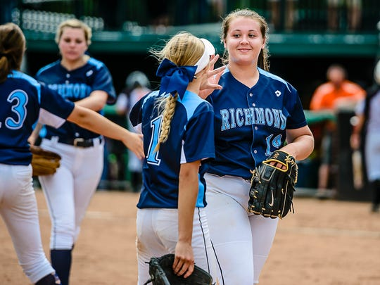 Richmond pitcher Erin Shuboy, right, smiles as she gets a high-five from teammate Carley Barjaktorovich after striking out Claire McInerny of Escanaba to close out the Escanaba half of the 6th inning of their Division 2 state semifinal game Thursday June 15, 2017 at Seccia Stadium in East Lansing.  KEVIN W. FOWLER PHOTO