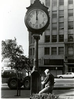 Edgar Bush is shown Oct. 28, 1973, making final adjustments after repairs to the clock that had been returned to San Jacinto Plaza.