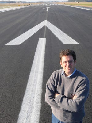 Salisbury-Ocean City-Wicomico Regional Airport manager Robert Bryant stands on the runway. According to Bryant, the county has invested $54 million over 11 years toward capital improvement projects which saw matching federal or state funds.