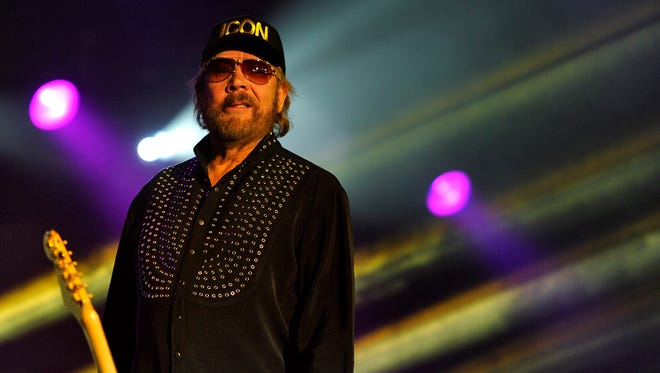 Hank Williams Jr. takes the stage as he prepares to perform at the NRA Country Jam on Broadway on April 10.
