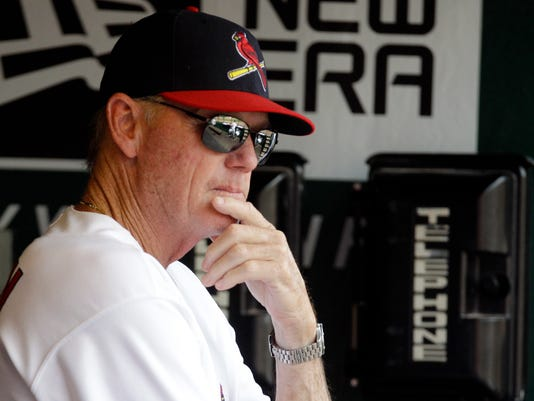 FILE - In this June 26, 2011, file photo, St. Louis Cardinals pitching coach Dave Duncan watches from the dugout during an interleague baseball game against the Toronto Blue Jays in St. Louis. The Chicago White Sox have hired longtime major league pitching coach Dave Duncan as a consultant, the team announced Thursday,  Feb. 8, 2018. (AP Photo/Jeff Roberson, File)