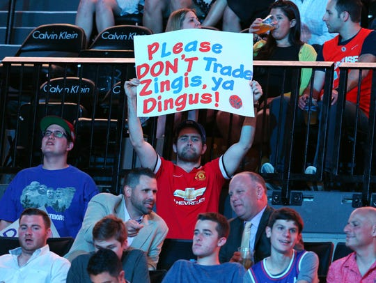 \A basketball fan holds up a sign referencing New York