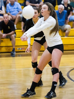 Bishop Verot's Alyssa Collins (C) tries to save the ball during against Cardinal Mooney in a Region 4A-3 quarterfinal on Wednesday, October 28, 2015 in Fort Myers Fla.