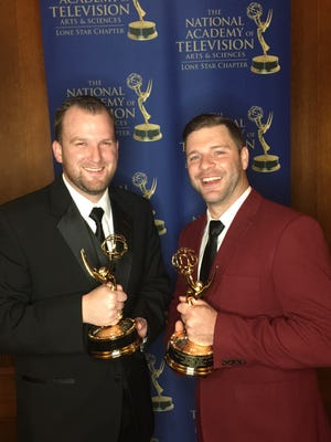 "Filmmakers Brian Groves and Brandon Whitford display their Emmy trophies for ""Shattered Dreams""."