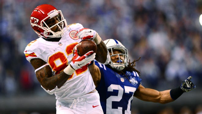 Kansas City Chiefs wide receiver Dwayne Bowe (82) tries to make  a catch against the  Indianapolis Colts during AFC wild card playoff football game at Lucas Oil Stadium in Indianapolis on Jan. 4, 2014.