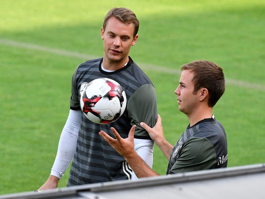 Germany's Manuel Neuer, left, and Mario Goetze talk during a training session in Duesseldorf, Germany, prior a friendly soccer match against Finland, Monday, Aug. 29, 2016. The world champion meets Finland next Wednesday in Moenchengladbach, Germany. (AP Photo/Martin Meissner)