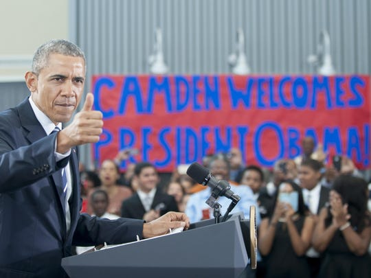 President Barack Obama gestures towards the crowd prior to speaking at the Ray & Joan Kroc Corps Community Center in Camden on Monday.