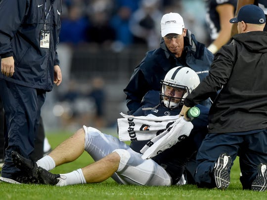 Penn State kicker Joey Julius receives assistance after being knocked down by Minnesota's Jaylen Waters during a kickoff in the second half Saturday. Waters was ejected from the game for unsportsman like conduct for targeting Julius.