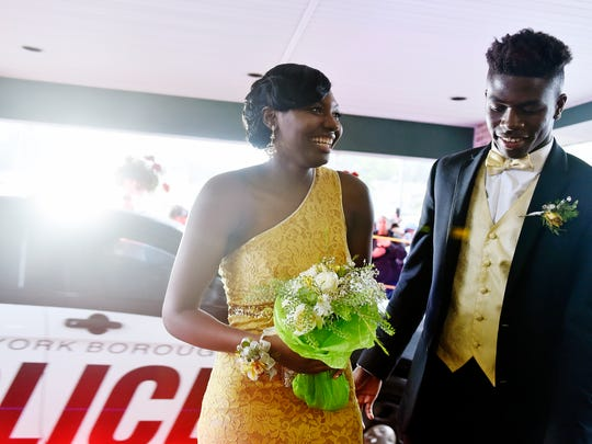 William Penn senior Shaniece Holmes-Brown and York Country Day senior Jordan Ray attend William Penn's prom Saturday, May 13, 2017, at Wisehaven Event Center in Windsor Township.
